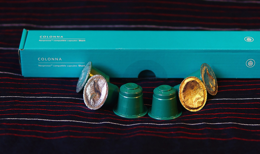 Huatusco Coe turqouise coffee capsules from Mexico by Colonna Coffee on a dark background