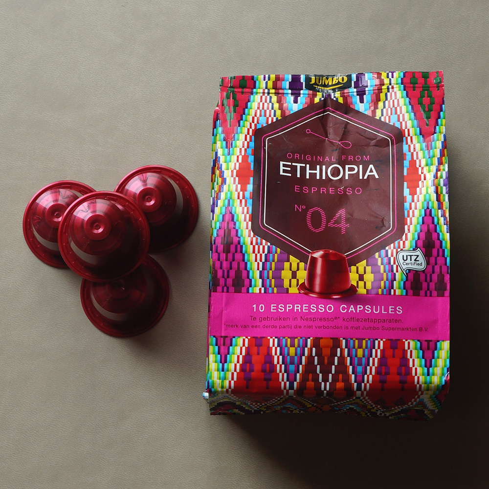 Ethiopia by Jumbo - dark red capsules with colourful packaging bag on a grey background