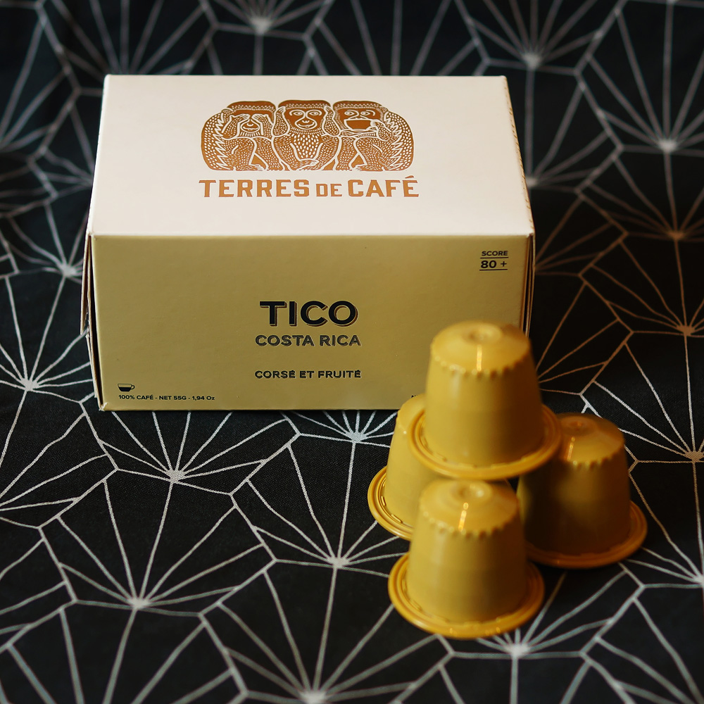 Tico, Costa Rica by Terres de Café - yellow capsules with the box on a dark background