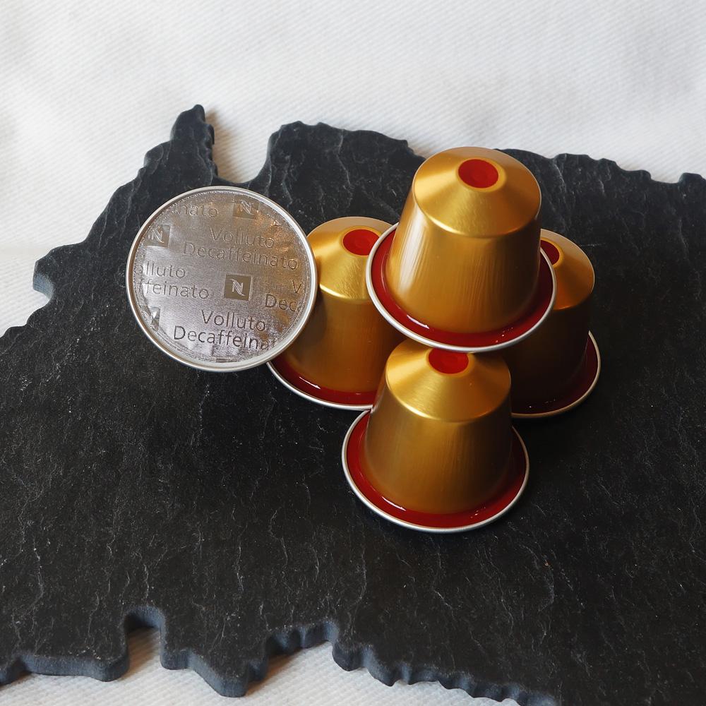 Volluto Decaffeinato by Nespresso - bright yellow coffee capsules on slate background