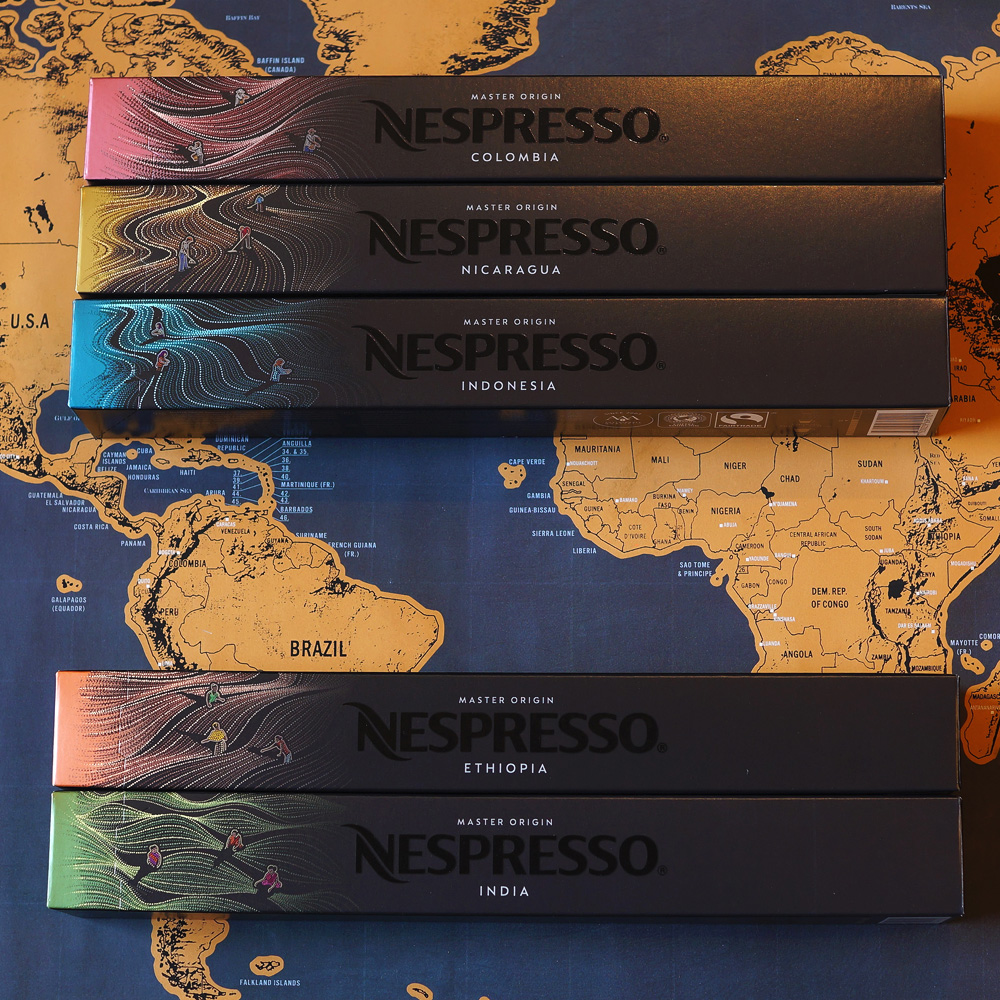 New Nespresso Master Origin capsules - five coffee boxes on a map as a background
