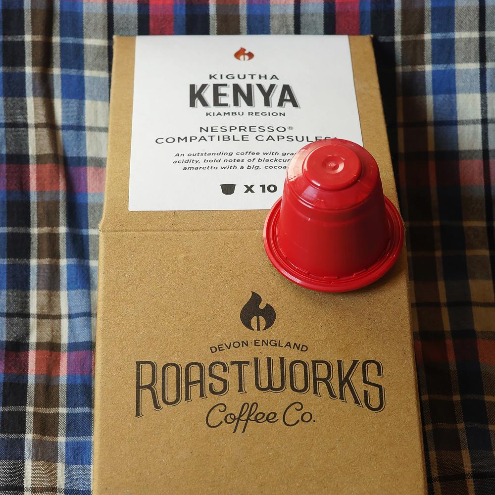 Kenya by Roastworks - a single red coffee capsule on a brown paper backaging