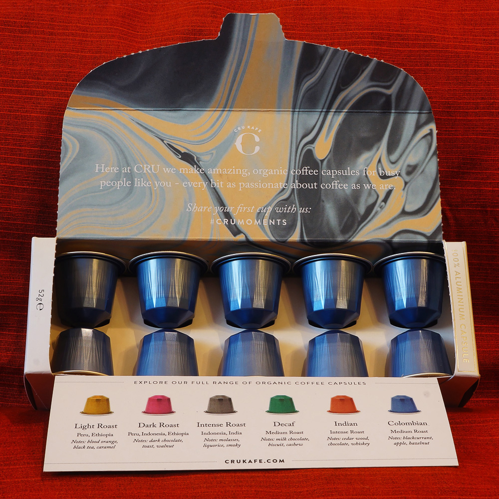 Organic Colombian by Cru Kafe - coffee box with 10 blue aluminium capsules on a red background