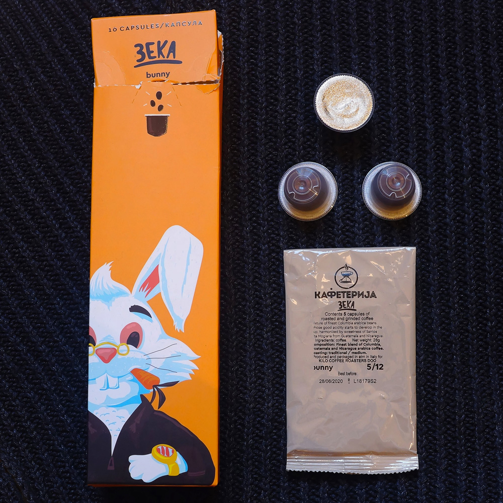 Zeka (Bunny) three coffee capsules with orange packaging box on the dark grey background