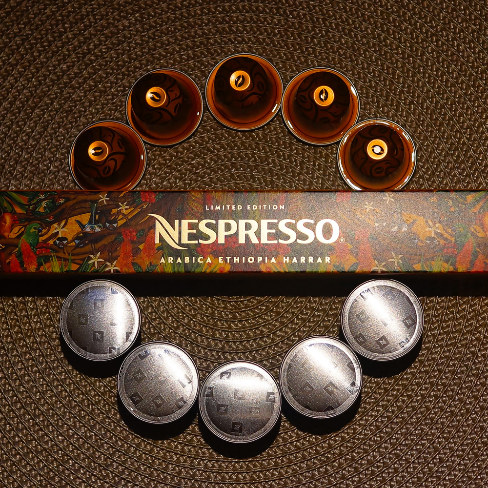 Arabica Ethiopia Harrar by Nespresso - 10 coffee capsules and a box on a brown background