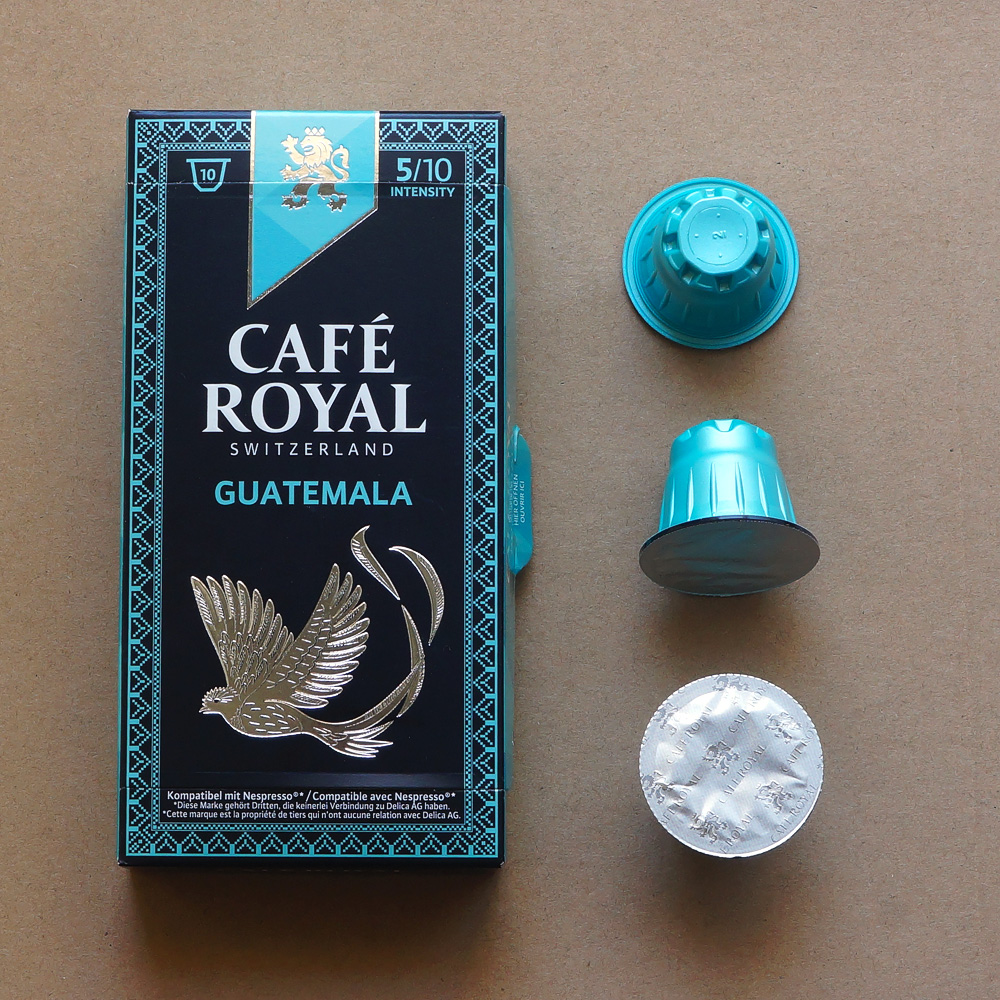 Guatemala by Café Royal - three light blue coffee capsules with a box on beige background