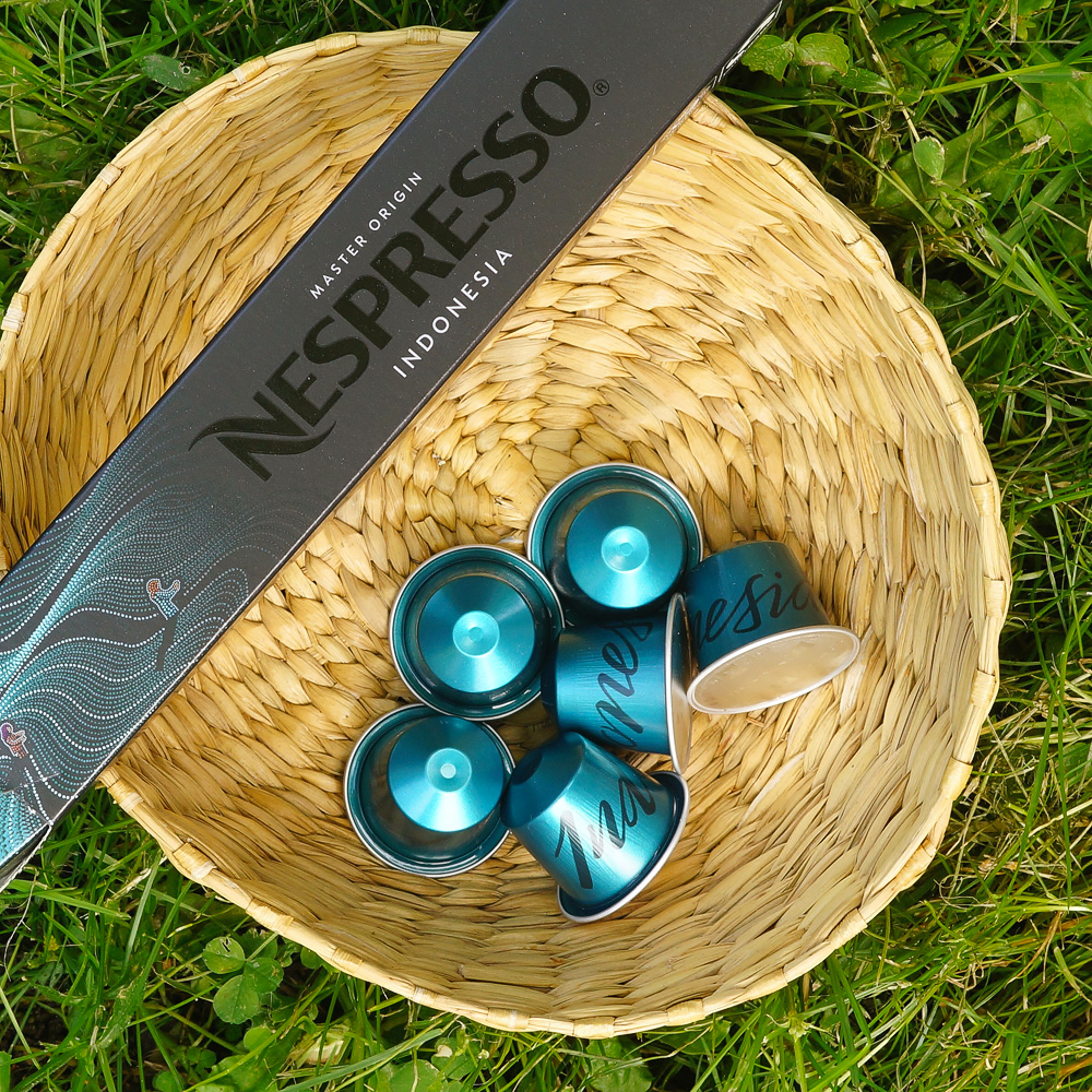 Six brighly blue coffee capsules of Nespresso Indonesia brand and a sleeve box in the basket