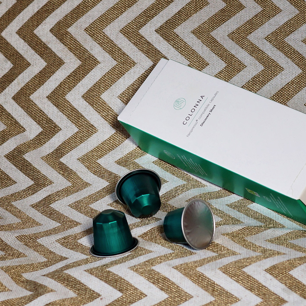 Colonna Coffee capsule box with green coffee pods